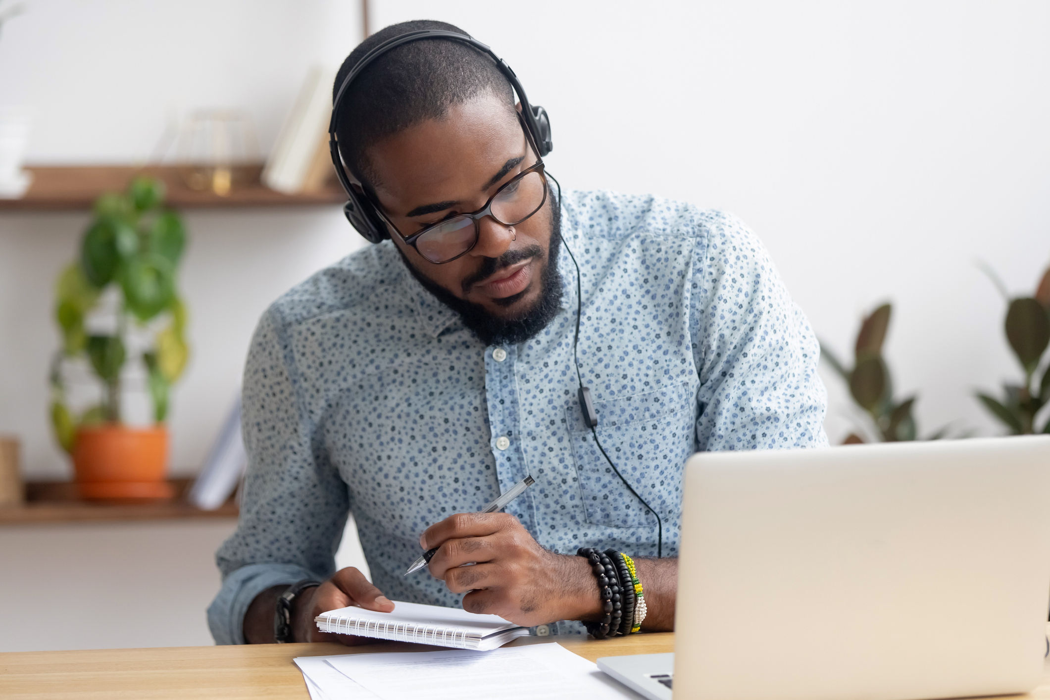 focused young man studies for online class