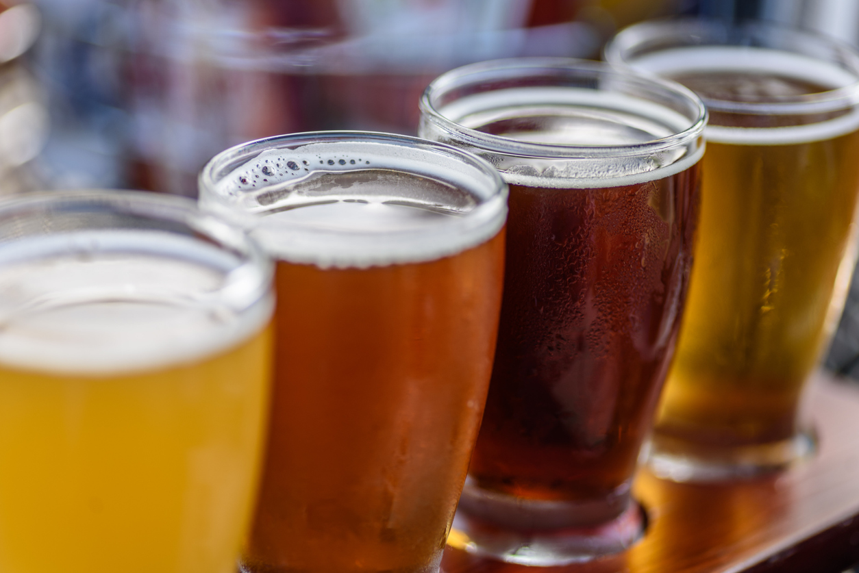 flight of craft beer at a brewery