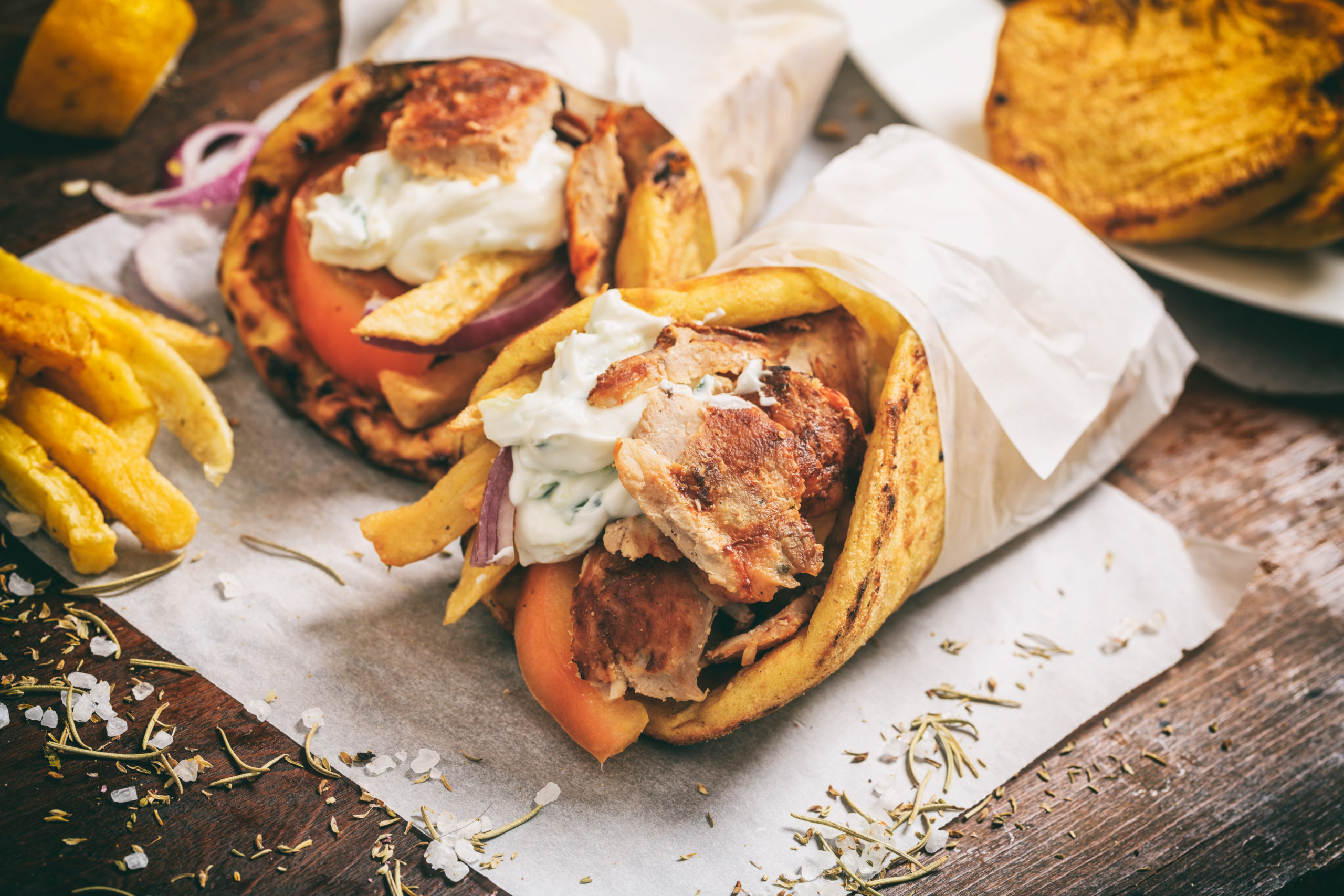 Takeout gyros on a plate.