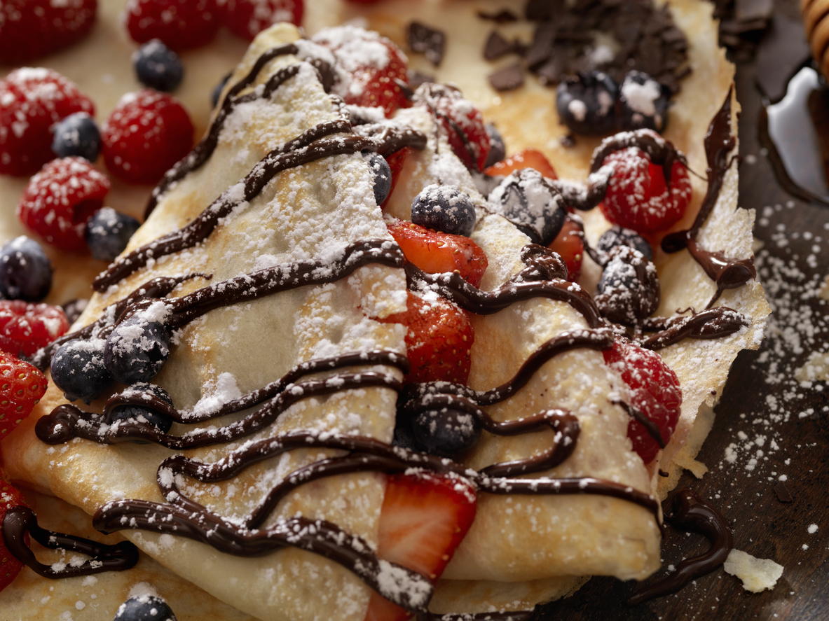 French crepes with berries and chocolate