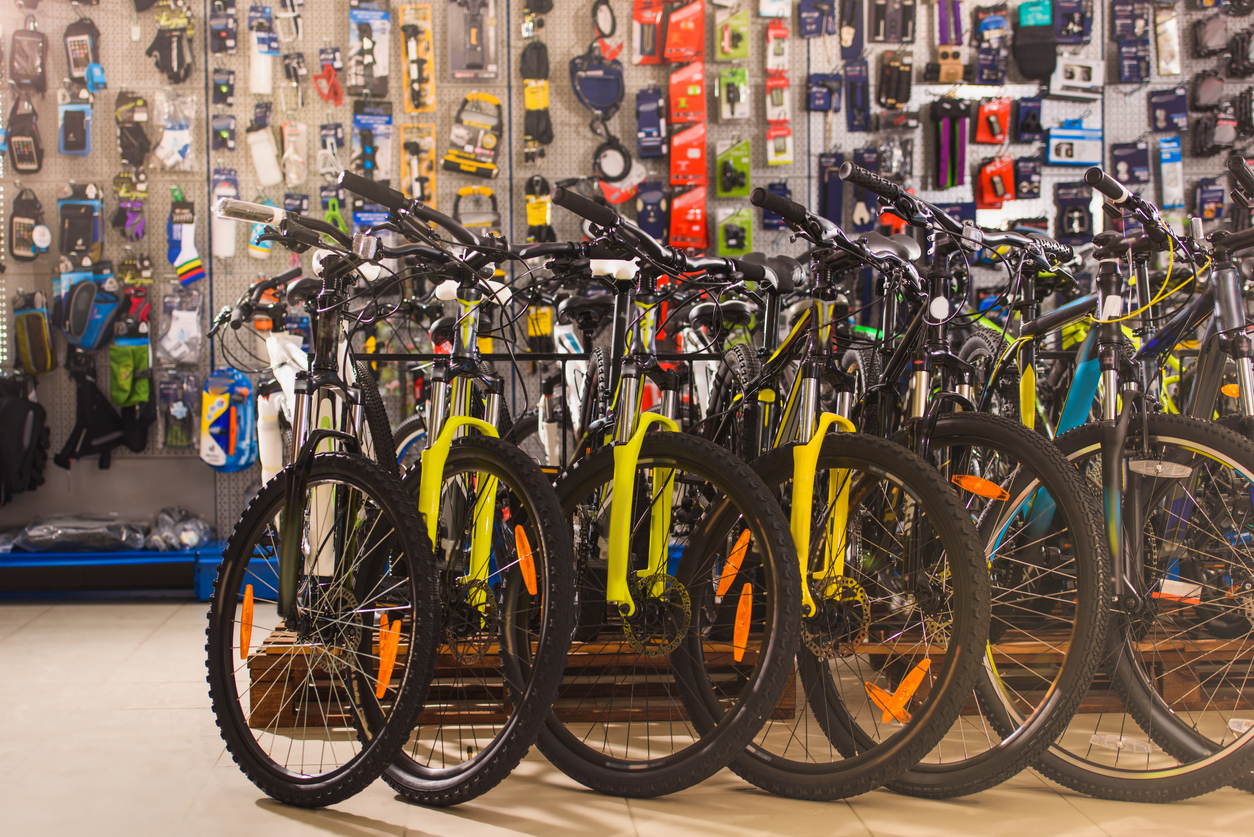 Different colored bikes lined up in a Germantown bike shop