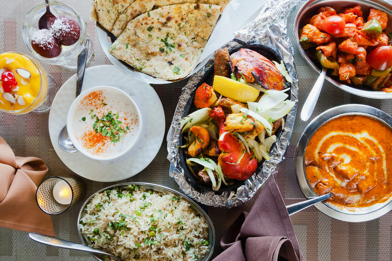 Several Indian food options from Germantown restaurants placed on a table.