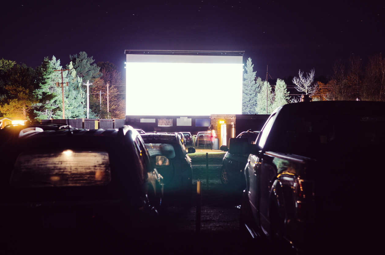Several cars parked during a movie showing at a drive-in theater near Germantown.