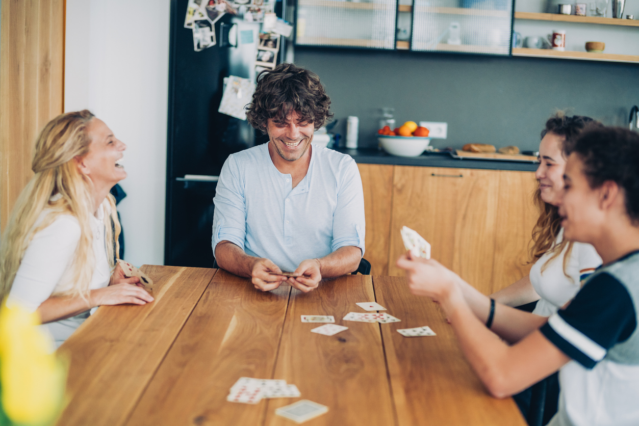 Group of friends playing a card game ordered from tabletop game stores in Germantown